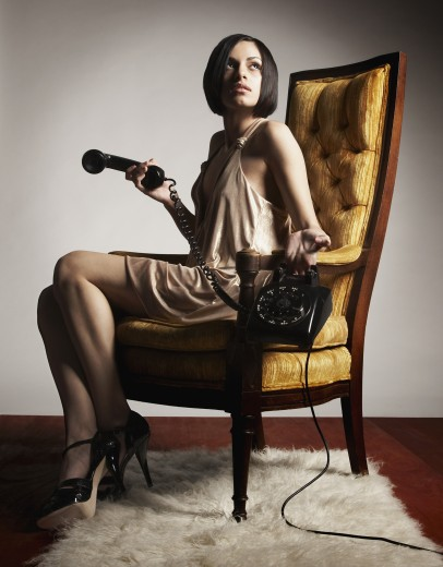 Hispanic woman holding telephone : Stock Photo