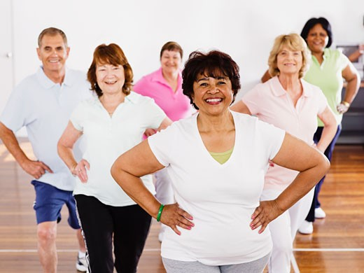 Stock Photo: 1589R-61268 Multi-ethnic adults taking exercise class