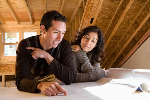 Stock Photo: 1589R-61434 Hispanic couple looking at blueprints