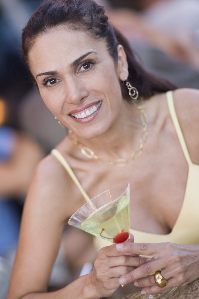 Stock Photo: 1589R-61753 Mixed race woman holding martini glass