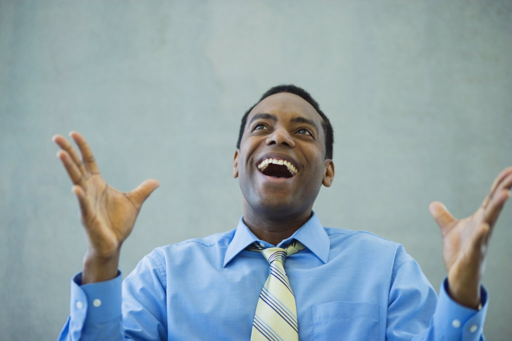African businessman smiling and gesturing : Stock Photo