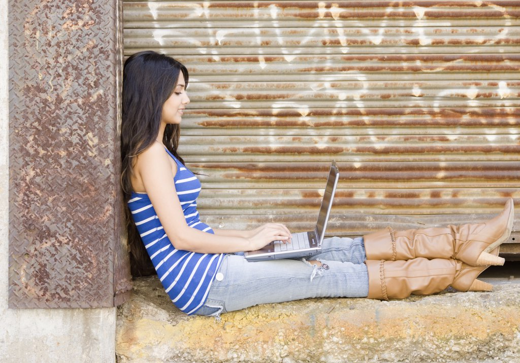 Stock Photo: 1589R-61978 Middle Eastern woman typing on laptop
