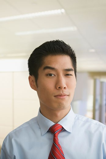 Stock Photo: 1589R-62148 Korean businessman raising eyebrow