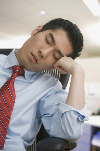 Stock Photo: 1589R-62151 Korean businessman sleeping in chair