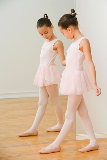 Stock Photo: 1589R-62183 Hispanic girl practicing ballet