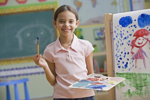 Stock Photo: 1589R-62200 Hispanic girl painting in classroom