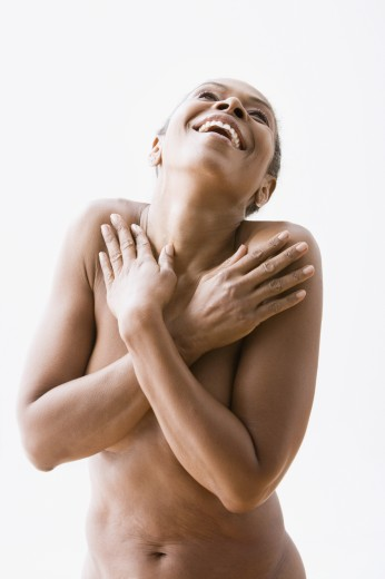 Stock Photo: 1589R-62359 Mixed race woman covering naked chest