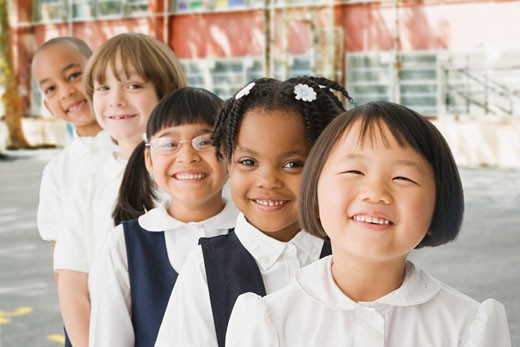 Stock Photo: 1589R-62386 Multi-ethnic school children in a row outdoors