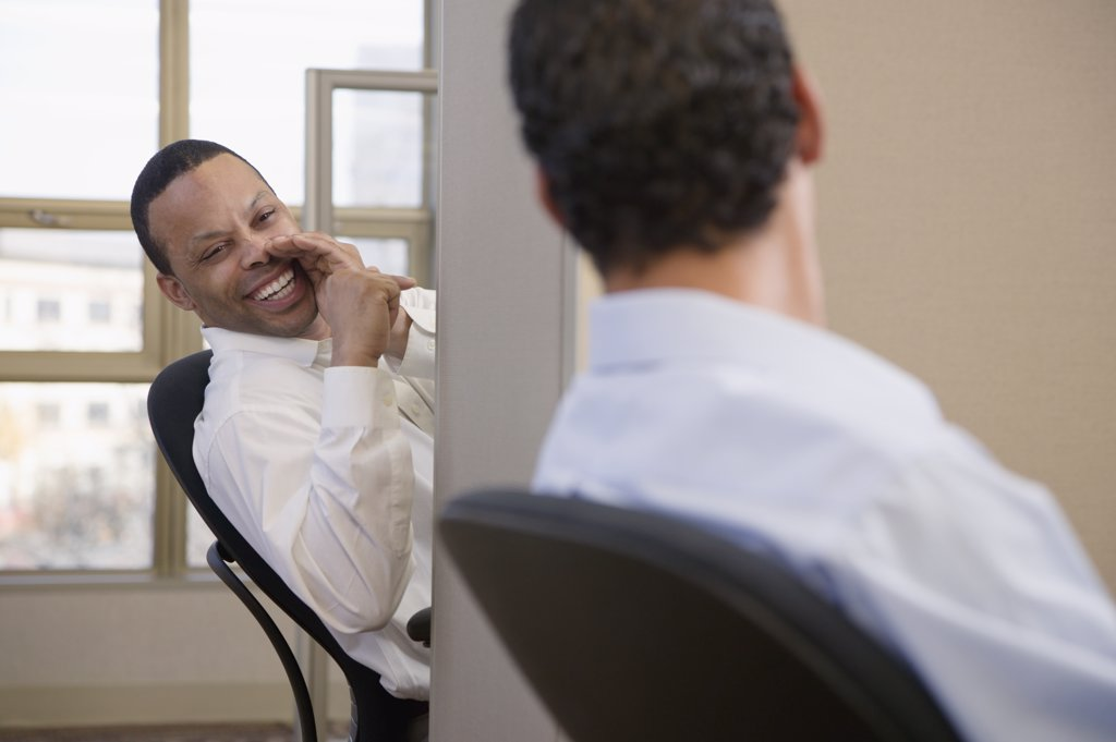Stock Photo: 1589R-62581 Businessmen exchanging gossip