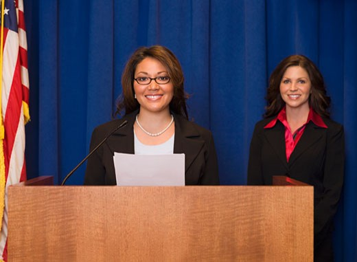 Stock Photo: 1589R-62929 Hispanic businesswoman speaking at podium