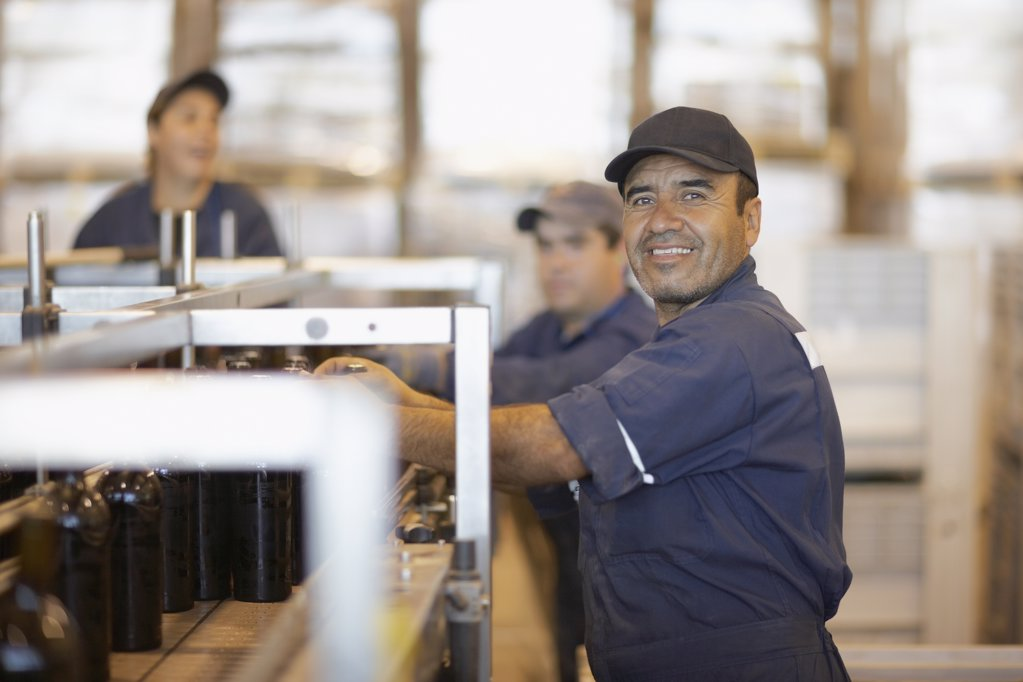 Stock Photo: 1589R-62970 Hispanic man working in bottling factory