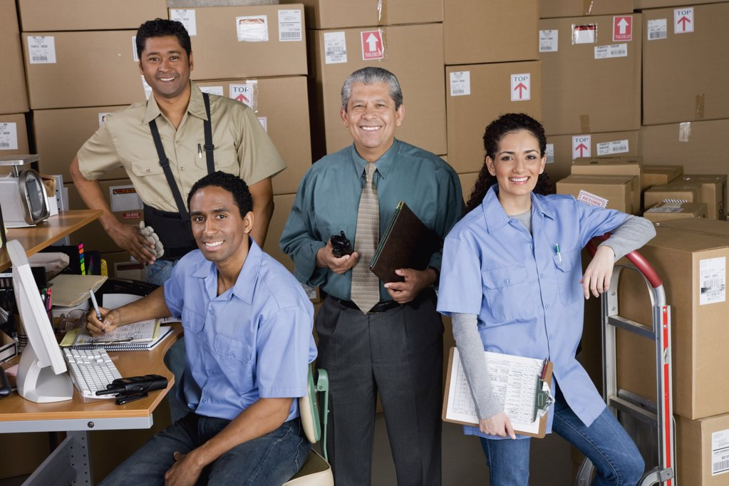 Co-workers in shipping office : Stock Photo