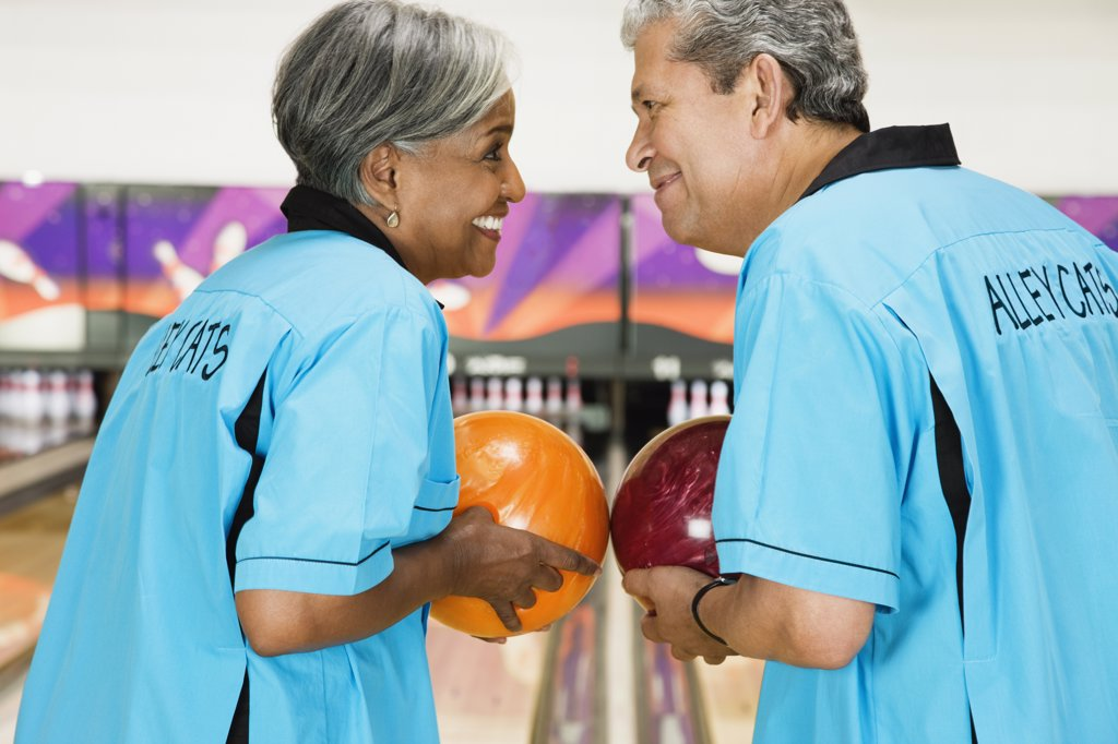 Stock Photo: 1589R-63131 Two friends on bowling league about to bowl