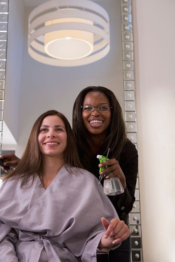 Woman having hair cut in beauty salon : Stock Photo