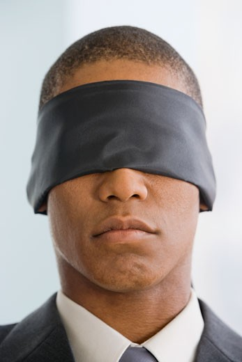 Stock Photo: 1589R-63367 Mixed race businessman wearing blindfold