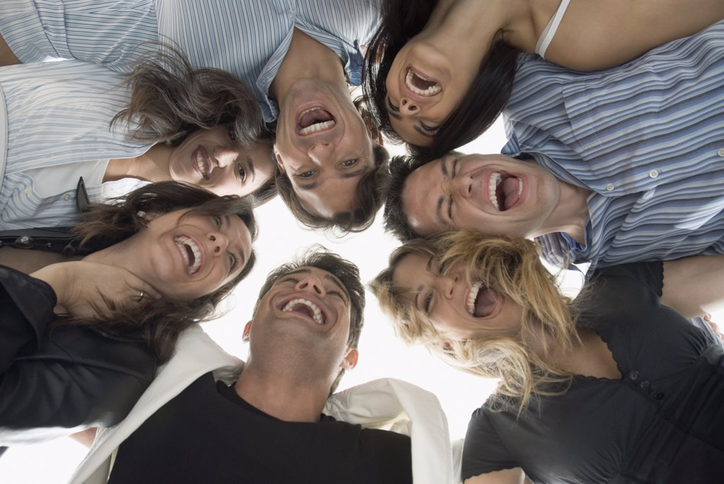 Stock Photo: 1589R-63745 Laughing Hispanic friends hugging