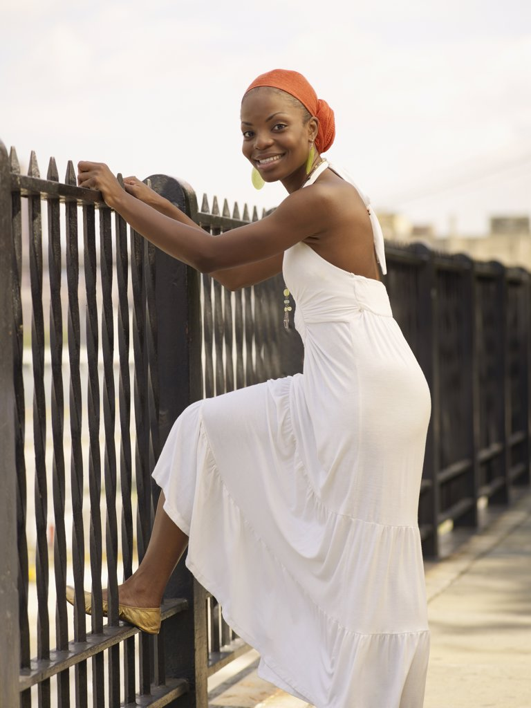 Stock Photo: 1589R-63944 African woman leaning on railing