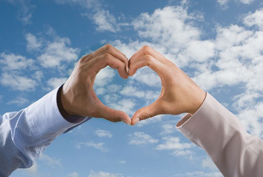Stock Photo: 1589R-64202 Multi-ethnic hands making heart-shape formation