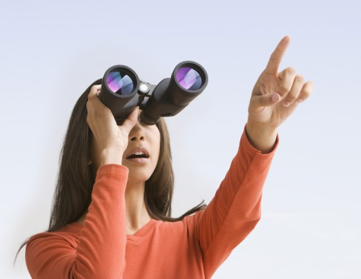 Stock Photo: 1589R-64223 Mixed race woman looking through binoculars