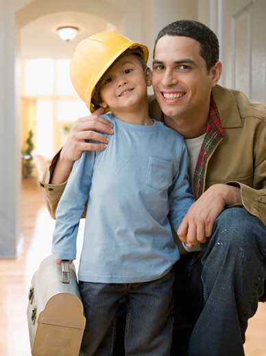 Stock Photo: 1589R-64270 Hispanic construction worker hugging son