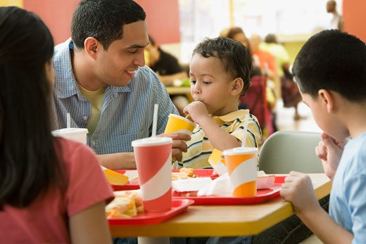 Stock Photo: 1589R-64276 Hispanic family eating in fast food restaurant