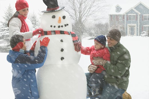 Stock Photo: 1589R-64286 Hispanic family making snowman