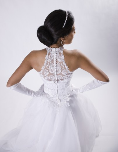 Stock Photo: 1589R-64417 Hispanic bride with hands on hips