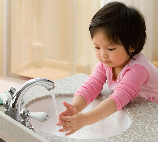 Stock Photo: 1589R-64540 Mixed race girl washing her hands