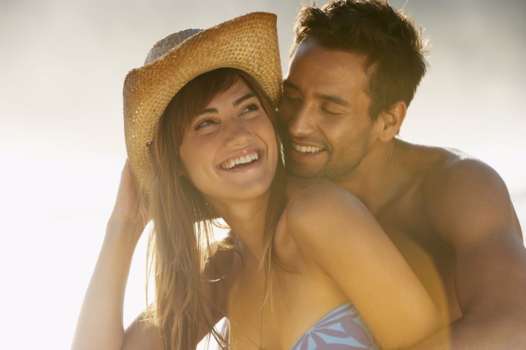 Smiling couple hugging : Stock Photo
