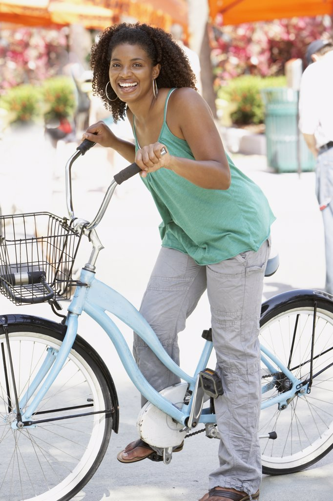 African woman riding bicycle : Stock Photo