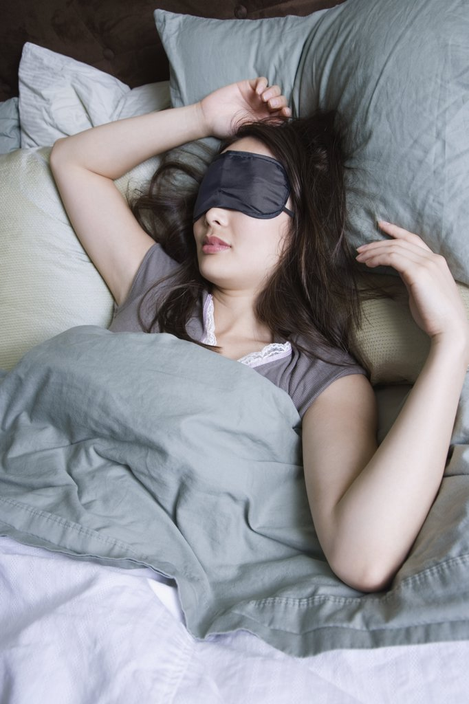 Woman sleeping with eye mask : Stock Photo