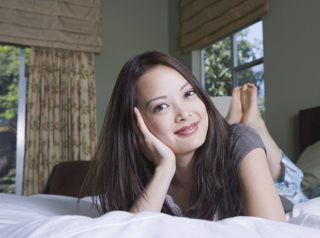 Stock Photo: 1589R-65150 Woman relaxing in bed