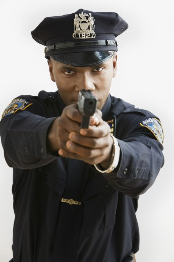 Stock Photo: 1589R-65296 African policeman aiming handgun