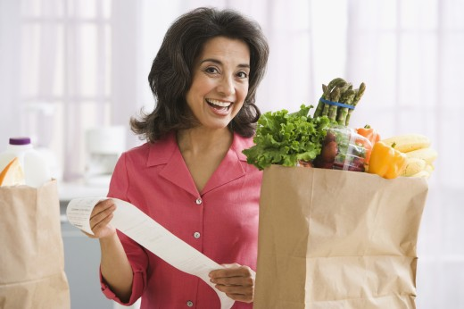 Stock Photo: 1589R-65367 Hispanic woman checking grocery receipt