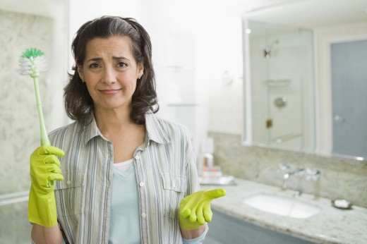 Hispanic woman in rubber-gloves with scrub brush : Stock Photo