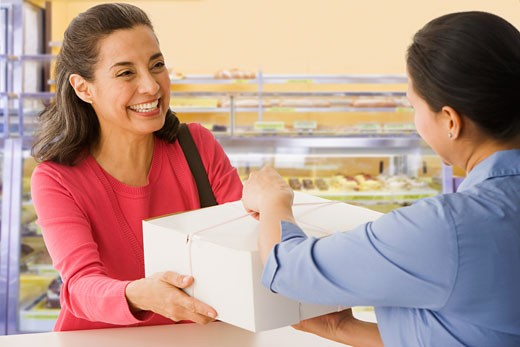 Stock Photo: 1589R-65424 Hispanic woman buying baked goods in bakery
