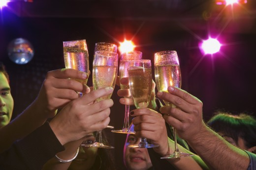 Stock Photo: 1589R-65526 Hispanic friends drinking champagne in nightclub