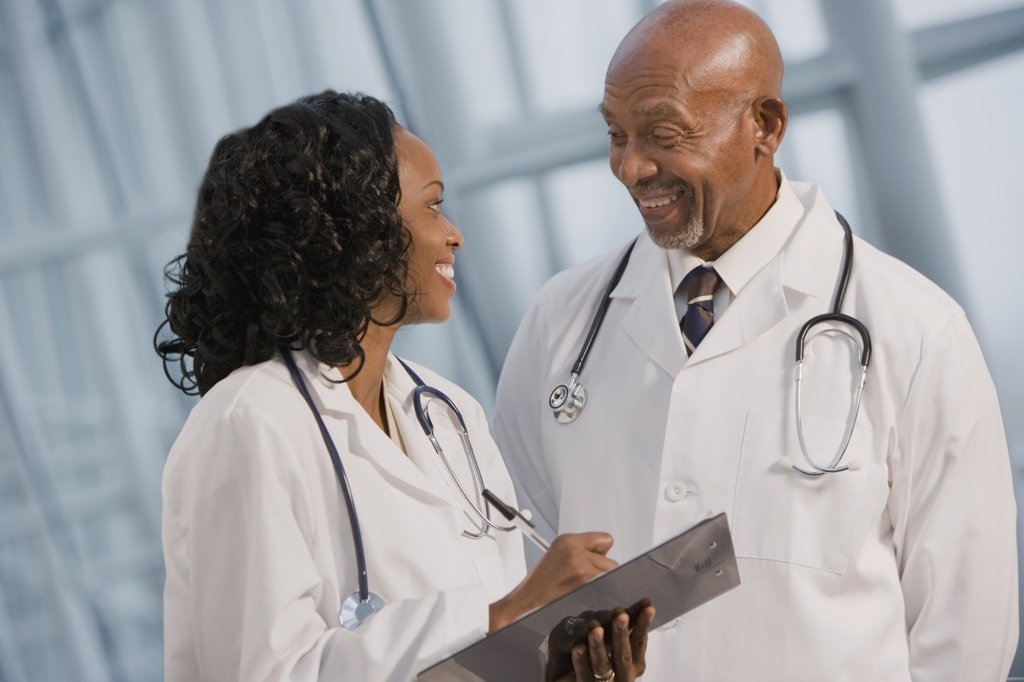 African doctors reviewing medical chart : Stock Photo