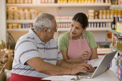 Stock Photo: 1589R-68916 Hispanic business owners using laptop