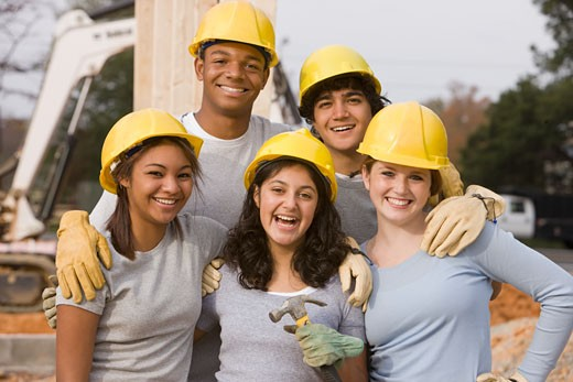 Stock Photo: 1589R-68960 Volunteers wearing hard-hats posing at construction site