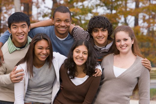Stock Photo: 1589R-68963 Young people hugging and smiling