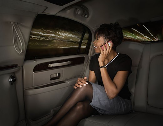Stock Photo: 1589R-69166 African woman using cell phone in car