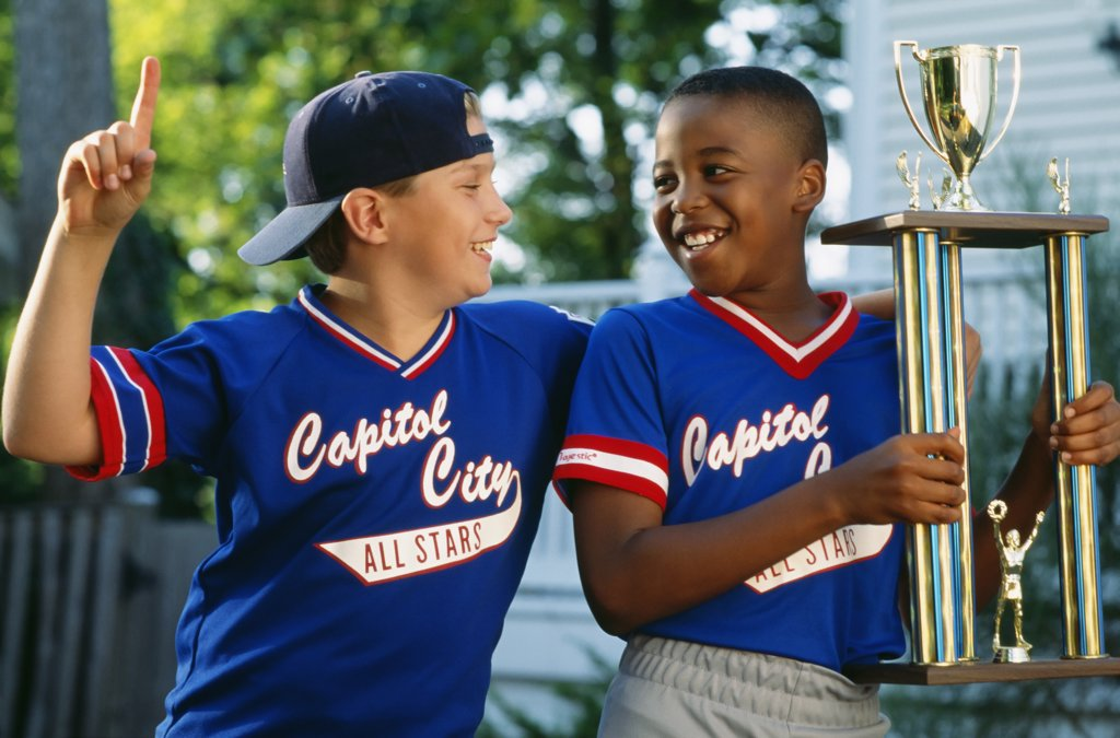Stock Photo: 1589R-69193 Two boys with baseball trophy