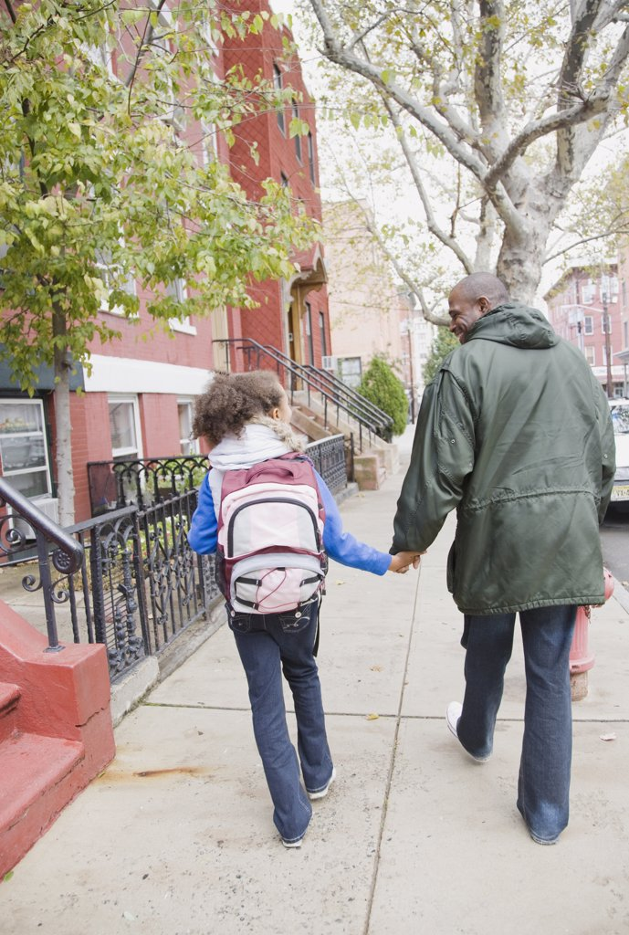 Stock Photo: 1589R-69262 African father and daughter holding hands