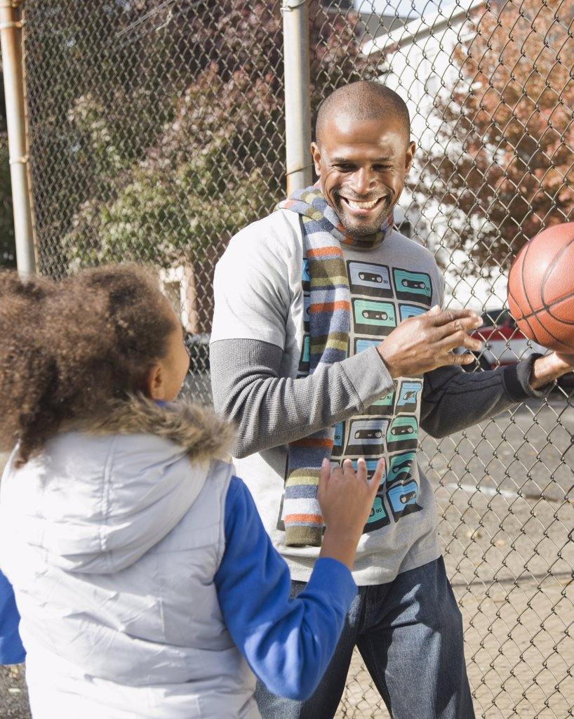 Stock Photo: 1589R-69266 African father and daughter playing basketball