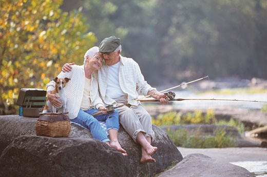 Stock Photo: 1589R-69621 Senior couple fishing on rocks