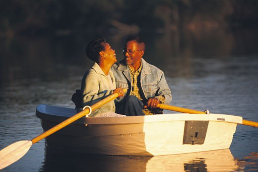 Stock Photo: 1589R-69622 Senior African couple in row boat
