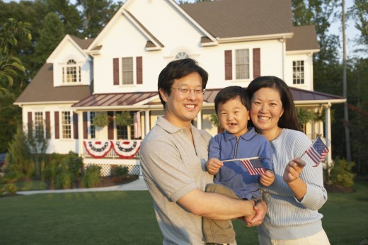 Stock Photo: 1589R-69698 Portrait of Asian family in front of house