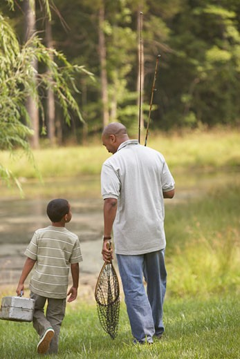 African father and son going fishing : Stock Photo