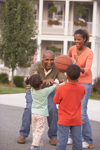 African family playing with basketball : Stock Photo